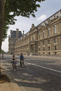 Couple riding a bicycle on the street of paris green way discovering Stock Photography