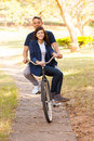 Couple riding bike cheerful teen a outdoors Stock Image