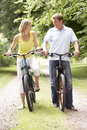 Couple riding bikes in countryside Stock Photo