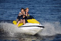 Couple riding jet ski happy smiling caucasian Royalty Free Stock Images
