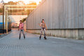 Couple is rollerblading. Royalty Free Stock Photo