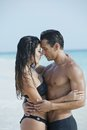 Couple romancing on the beach day time Royalty Free Stock Images
