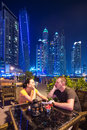 Couple on romantic dinner in dubai marina at night Royalty Free Stock Photo