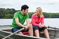 Couple in a rowboat Royalty Free Stock Image