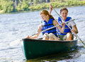 Couple rowing boat Stock Photography