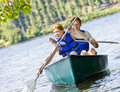 Couple rowing boat Royalty Free Stock Images