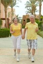 Couple run at tropic hotel resort senior Stock Photography