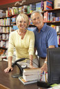 Couple running bookshop Stock Photos