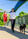 Couple running with dog Royalty Free Stock Images