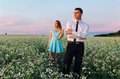 Couple running in field holding hands. Royalty Free Stock Photo