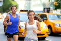 Couple running on fifth avenue new york nyc active famous shopping street in manhattan city usa exercise lifestyle portrait of Stock Image