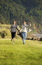 image photo : Couple running, holding hands