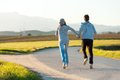 Couple running outdoors. Stock Photo