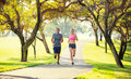 Couple running together in the park Royalty Free Stock Photos
