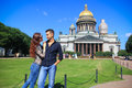 Couple in saint petersburg russia young women and handsome men next to isaac cathedral Stock Photography