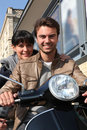 Couple sat on a motorbike Royalty Free Stock Photography