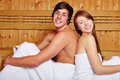 Couple in sauna leaning on each Royalty Free Stock Image