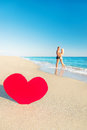 Couple at sea beach and big red heart lovers embrace st valentines day concept Royalty Free Stock Photos