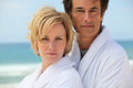 Couple by the sea in matching bath robes Royalty Free Stock Photo