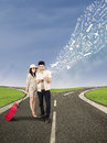 Couple search online for holiday destination standing on the road looking Royalty Free Stock Image