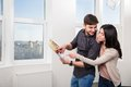 Couple in searching the real estate for a purchase young pair Stock Photo