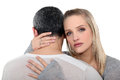 Couple in a serious embrace tender Royalty Free Stock Photography