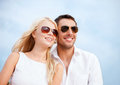 Couple in shades at sea side summer holidays and dating concept Stock Photo