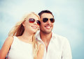 Couple in shades at sea side summer holidays and dating concept Royalty Free Stock Photos