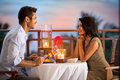 Couple sharing romantic sunset dinner Royalty Free Stock Photo