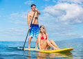 Couple sharring stand up paddle board attractive hawaii Stock Photo