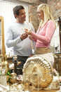 Couple shopping for antiques Royalty Free Stock Image