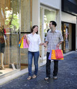 Couple with shopping bags in front of a store Stock Images
