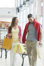 Couple with shopping bags in mall Royalty Free Stock Photos