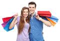 Couple with shopping bags over white background Stock Photo