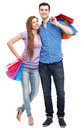 Couple with shopping bags over white background Stock Images