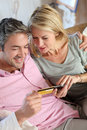 Couple shopping with credit card on internet upper view of paying mobile phone Royalty Free Stock Photos