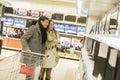 Couple shopping electronics Royalty Free Stock Photo