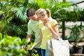 Couple shopping for plants Royalty Free Stock Photo