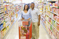 Couple shopping in supermarket Royalty Free Stock Image