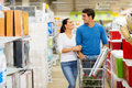Couple shopping supermarket lovely young at Royalty Free Stock Images