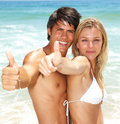 Couple showing a gesture at the beach Royalty Free Stock Image