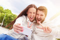 Couple showing peace sign Royalty Free Stock Photo
