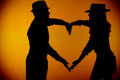 Couple silouette photography forming a heart Royalty Free Stock Photography