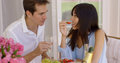 Couple sipping wine and eating fruit Royalty Free Stock Photo