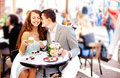 Couple sit in cafe drinking talking having fun laughing smiling happy Royalty Free Stock Photography