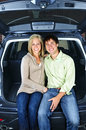 Couple sitting in back of car Stock Images
