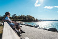 Couple Sitting on a Bench at Kitsilano Beach in Vancouver, Canad Royalty Free Stock Photo