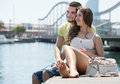Couple sitting on berth happy loving the at summer day Stock Images