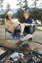 Couple Sitting By Bonfire Royalty Free Stock Image