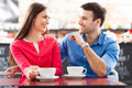 Couple sitting cafe drinking coffee Stock Photos